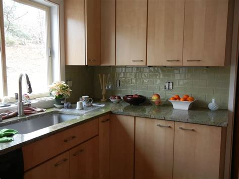 green glass subway tile  maple cabinets