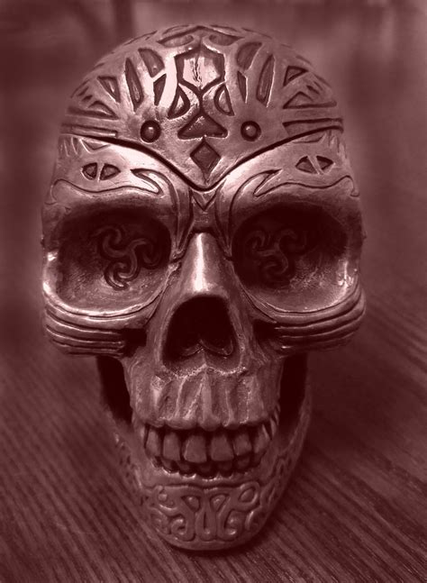 shallow focus photography  silver skeleton statue