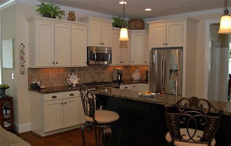 white cabinets black granite what color backsplash corner on pastel wall paint black glass tile backsplash