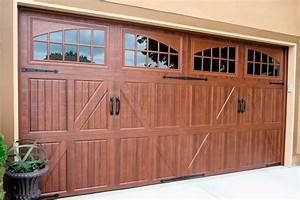 Why choose a carriage house style garage door doors by for Carriage style garage doors kit