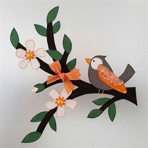fensterbild vogel auf ast orange fruehling dekoration
