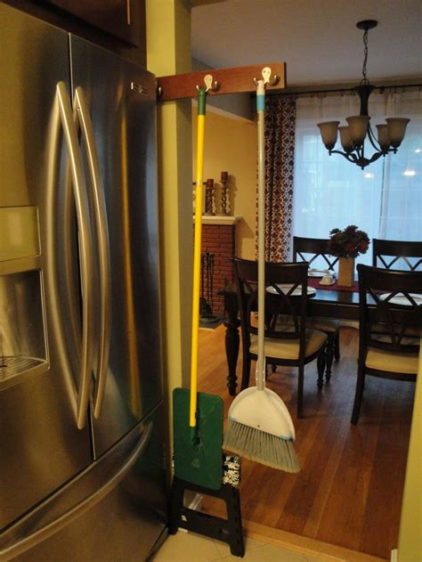 kitchen broom cabinet diy sliding broom holder fits in narrow space next to 2335