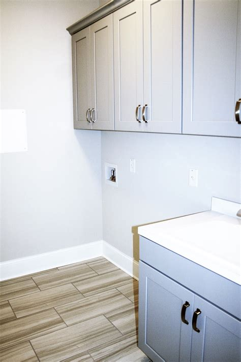 haven painted stone laundry cabinets tile