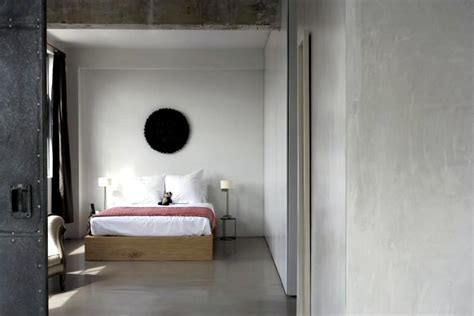gray and turquoise bedroom screed and concrete wall in the bedroom interior design
