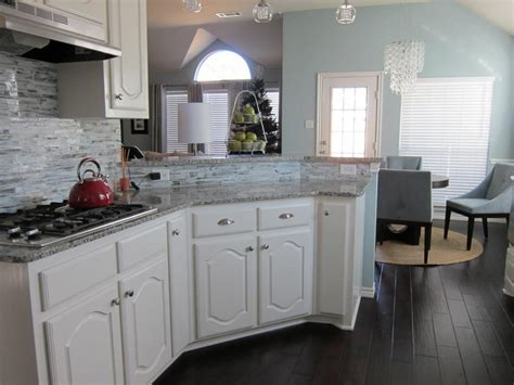 white kitchen cabinets  dark hardwood floors choice