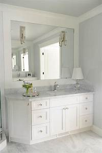 Bathroom vanity with angled cabinet transitional bathroom for Best brand of paint for kitchen cabinets with bathroom wall art sets