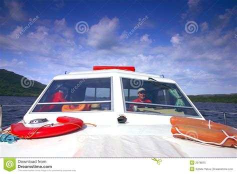 Driving Boat In Dream boat cruise on loch ness lake stock photo cartoondealer