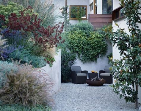 gravel courtyard small city walled garden gravel courtyard mix of mediterranean plants making the most of a