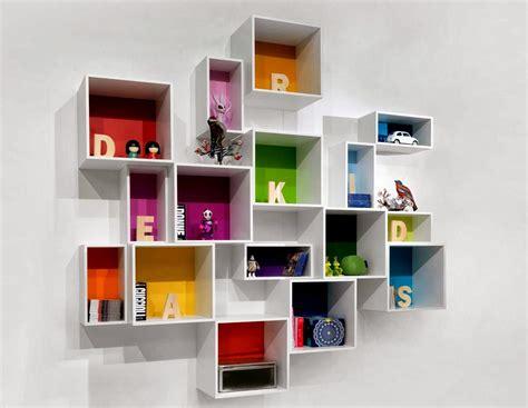 desain rak dinding minimalis termasuk rak buku