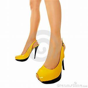 Female Legs In Yellow High Heels Stock Image