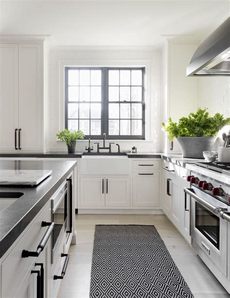 farmhouse kitchen white cabinets black countertops really like the undermount farmhouse sink like the matte
