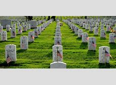 Old Guard Soldiers plant flags at Arlington Cemetery