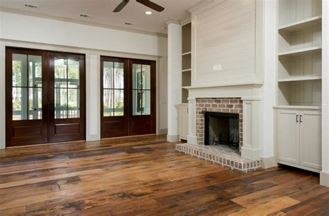 Living Room With Fireplace And Doors by Family Room With Brick Fireplace Custom Built Ins