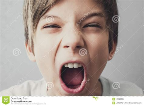 Angry boy screams stock image. Image of close, yelling - 109326035