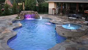 15 remarkable free form pool designs home design lover With free form swimming pool designs