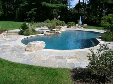 pool landscaping with rocks lovely kidney shaped pool with raise spa and diving rock landscape design portfolio hoffman