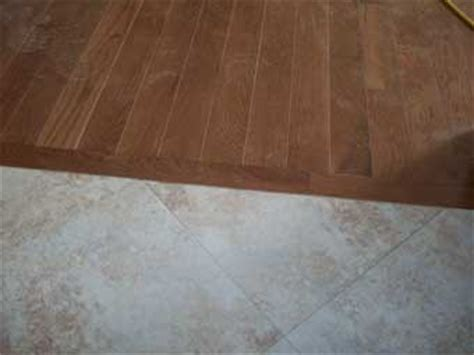 Wood To Tile Metal Transition Strips by Jeb Kennel Builders Flooring Contractor In Central Illinois