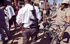 Group armed with rifles seen among protesters at Barack ...