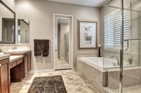 contemporary master bathroom with stone tile double sink