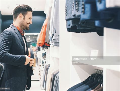 Smiling Handsome Man Buying Clothes High-Res Stock Photo ...