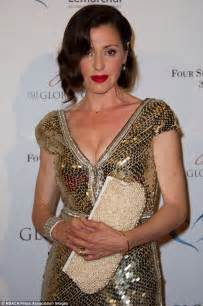 gift towers tina arena shimmers at gala in gold and silver gown
