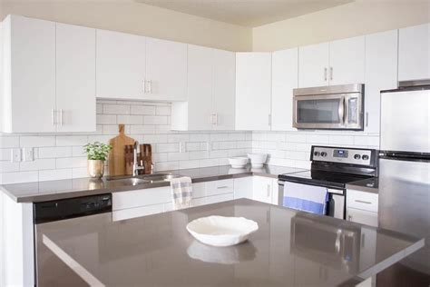 White Flat Front Cabinets With Grey Quartz Countertops