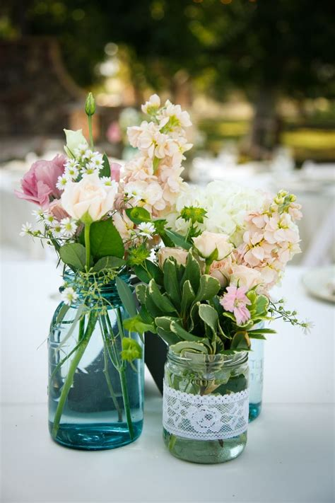 country wedding table flowers turquoise mason jars