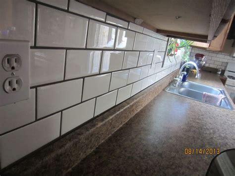 white subway tile backsplash  dark grout kitchen