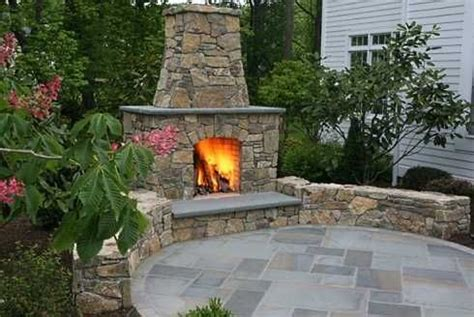 patio with outdoor fireplace around the