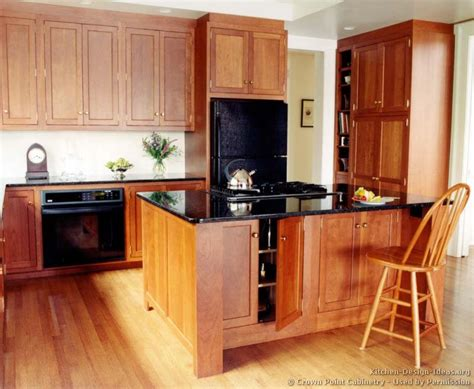 cherry oak cabinets kitchen kitchens with light wood cabinets and black countertops 5376