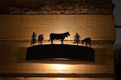 applique montagna applique a schermo mucche amoflex