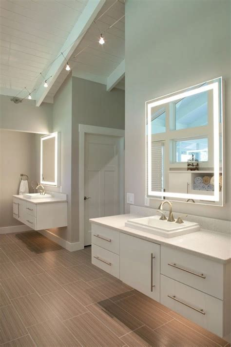 Master Bathroom Mirrors by Dual Vanities In Master Bathroom With Lighting Underneath
