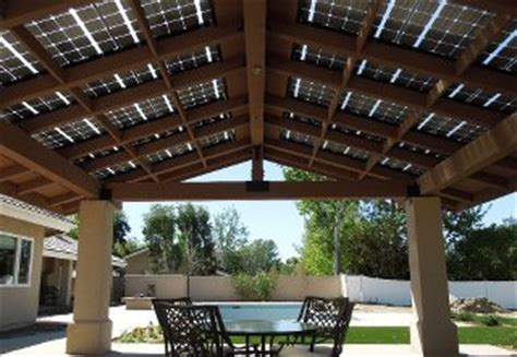 solar panels do duty as patio roof proud green home