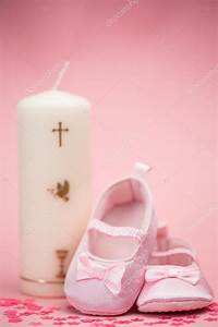 Pink baby booties with christening candle — Stock Photo ...