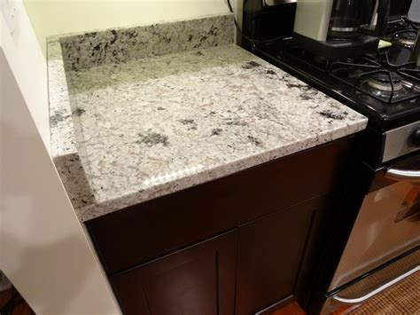 espresso cabinets with romano granite countertops