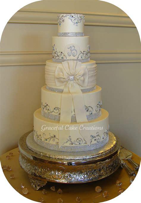 Elegant Ivory Buttercream Wedding Cake With Bling Ribbon