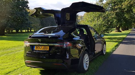 black tesla model    hire  weddings