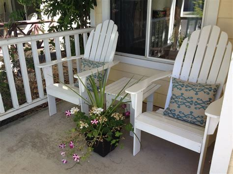 unique pair  white wooden adirondack chairs  cute
