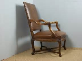 pair of leather upholstered gainsborough arm chair