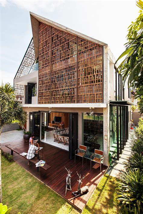 concrete teak  nifty design vibrant residence