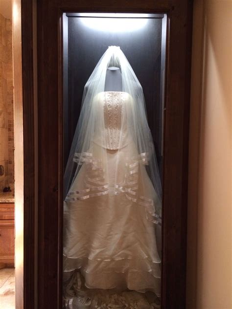 my clients wedding dress a built in shadow box with her