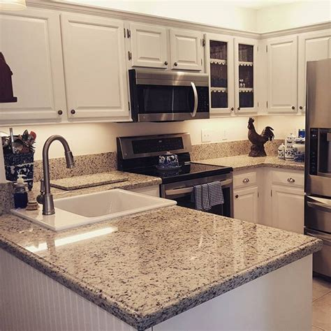 Beautiful Kitchen With Dallas White Granite Counter Tops