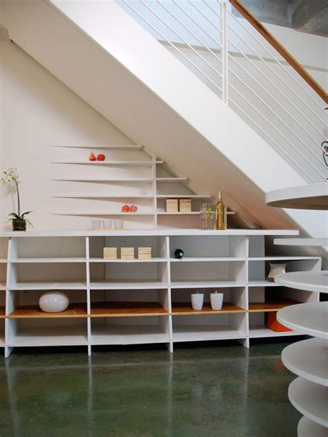 stairway shelving 40 under stairs storage space and shelf ideas to maximize your interiors in style