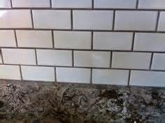 white subway herringbone tile under counter led lights