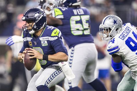 seahawks fall  cowboys tumble   playoffs