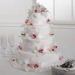 wedding cake ornament white fondant cake with orchids call us 206 728 2588 seattle flowers