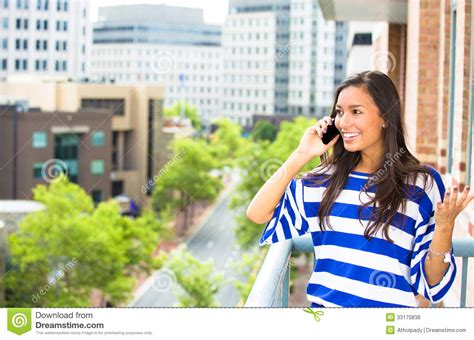 Beautiful Woman Talking On A Cell Phone Relaxed On A
