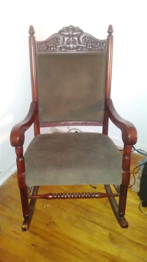 rocking chair   carved face