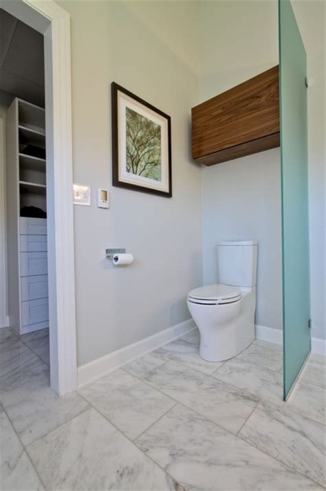 glass partition toilet area  walnut storage cabinet