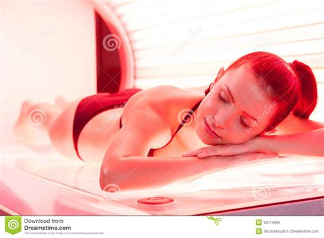 sunbathing on tanning bed stock photo image 40174506